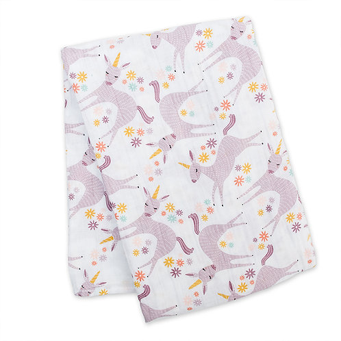 folded white blanket with pale lilac & gold unicorn print