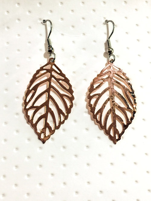 Rose gold colored earrings in filigree leaf shape