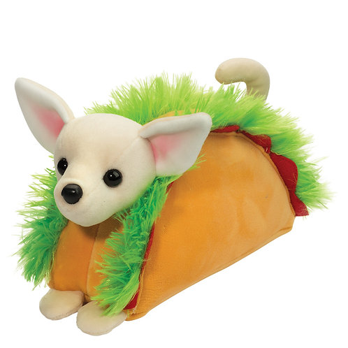 White plush stuffed chihuahua toy-pink inside ears-sitting in a golden brown taco shell with green trim to look like lettuce