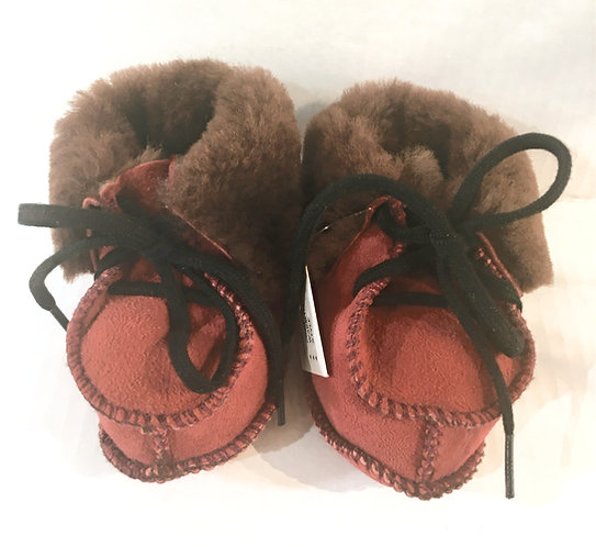 Front view of pair of baby's red sheepskin slippers-brown fleece interior-black laces