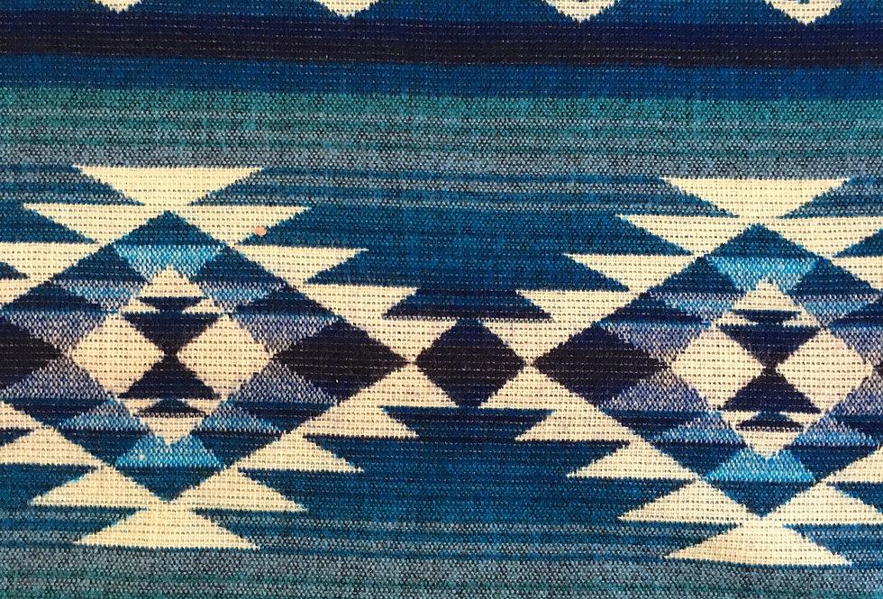 Close up of blue, teal & ivory patterned blanket