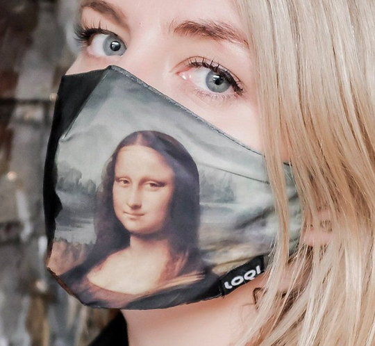 Close-up of Model wearing face mask-reproduction of Leonardo da Vinci's Mona Lisa