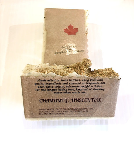 2 bars of patchouli scented handmade soap in kraft paper wrapper printed with ingredients and Made in Canada