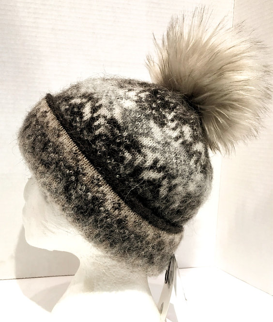 Cuffed wool toque with gray & white snowflake pattern on black & tan with light brown faux fur pompom