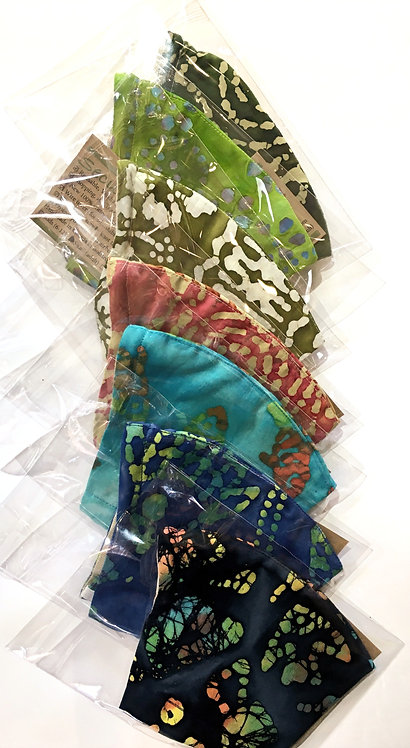 Row of 7 assorted batik print cotton protective masks