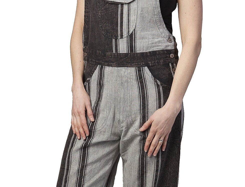 model wearing black & gray striped cotton overalls with pocket on front bib
