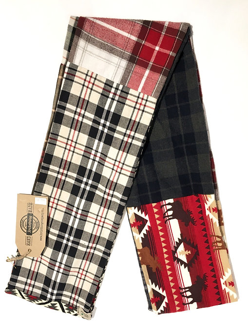 Side 1 of double sided patch flannel scarf, mostly white, green, black & red stripes & checks
