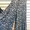 Black floral print wide leg pants, leg spread
