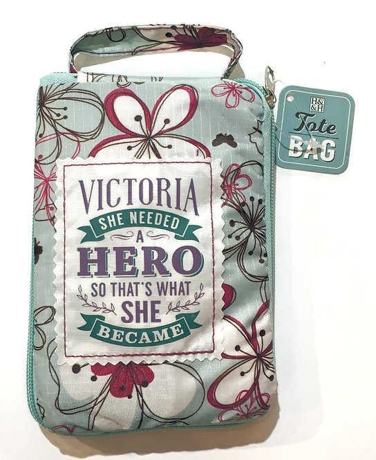 Green & purple folded reusable tote bag with text-Victoria she needed a hero so that's what she became