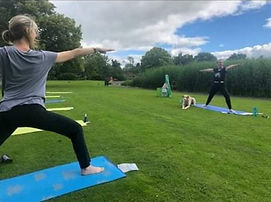 Moving into warrior poses at Yoga in the Park