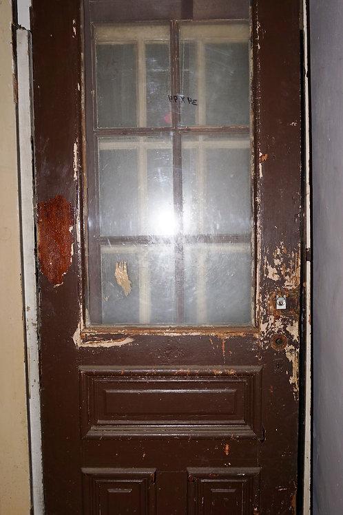 Paneled Door With One Glass Pane