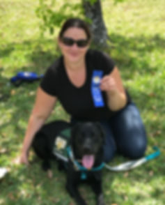 Jaime from Jaime Doolittle Dog Training, with a dog I trained to become a Therapy Dog