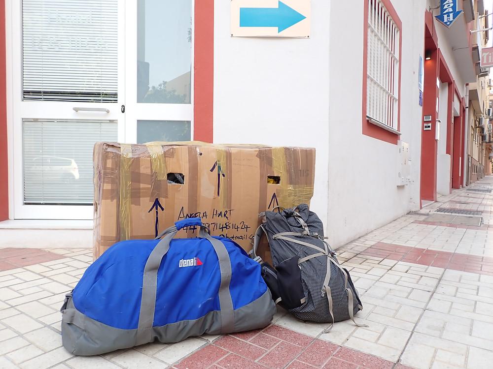 My bike box, holdall and rucksack outside the hostal