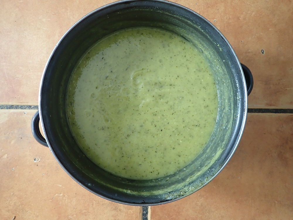 A large pan of courgette soup