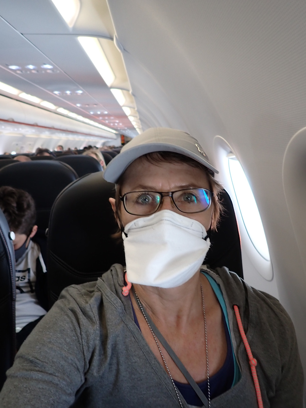 Me, on the plane with a face mask on