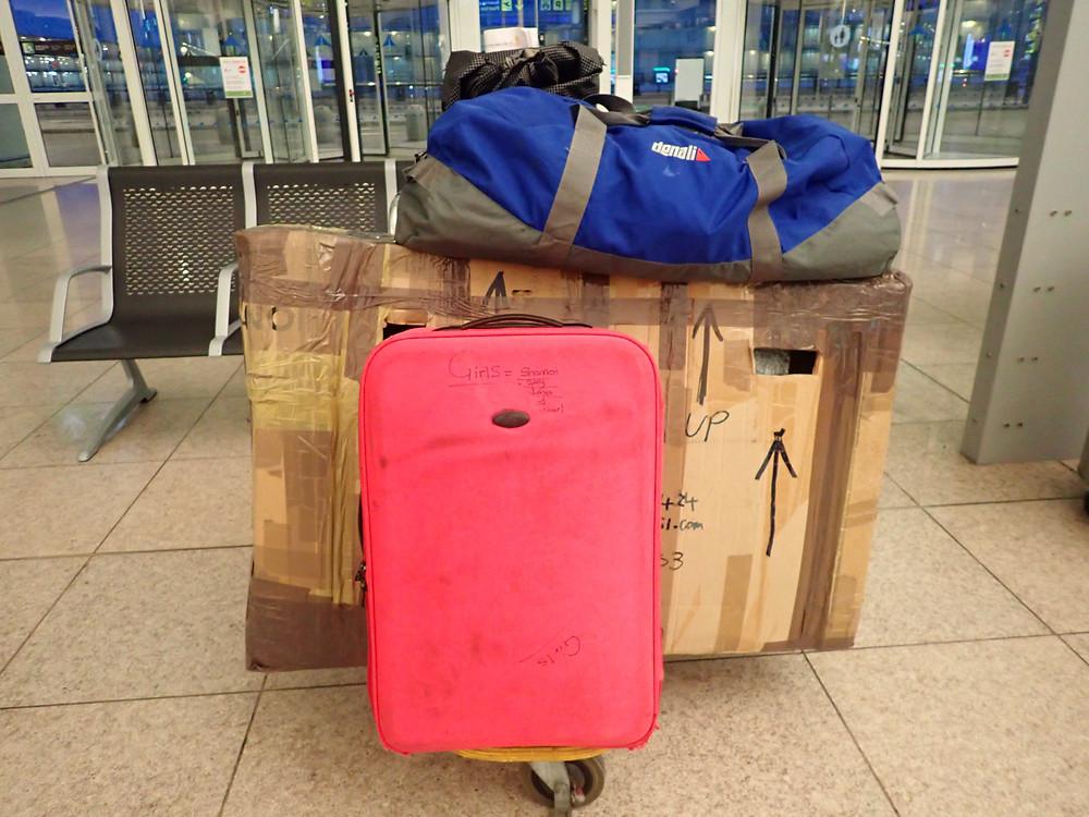 Inside Barcelona airport terminal, my bike and bikepacking gear on a trolley