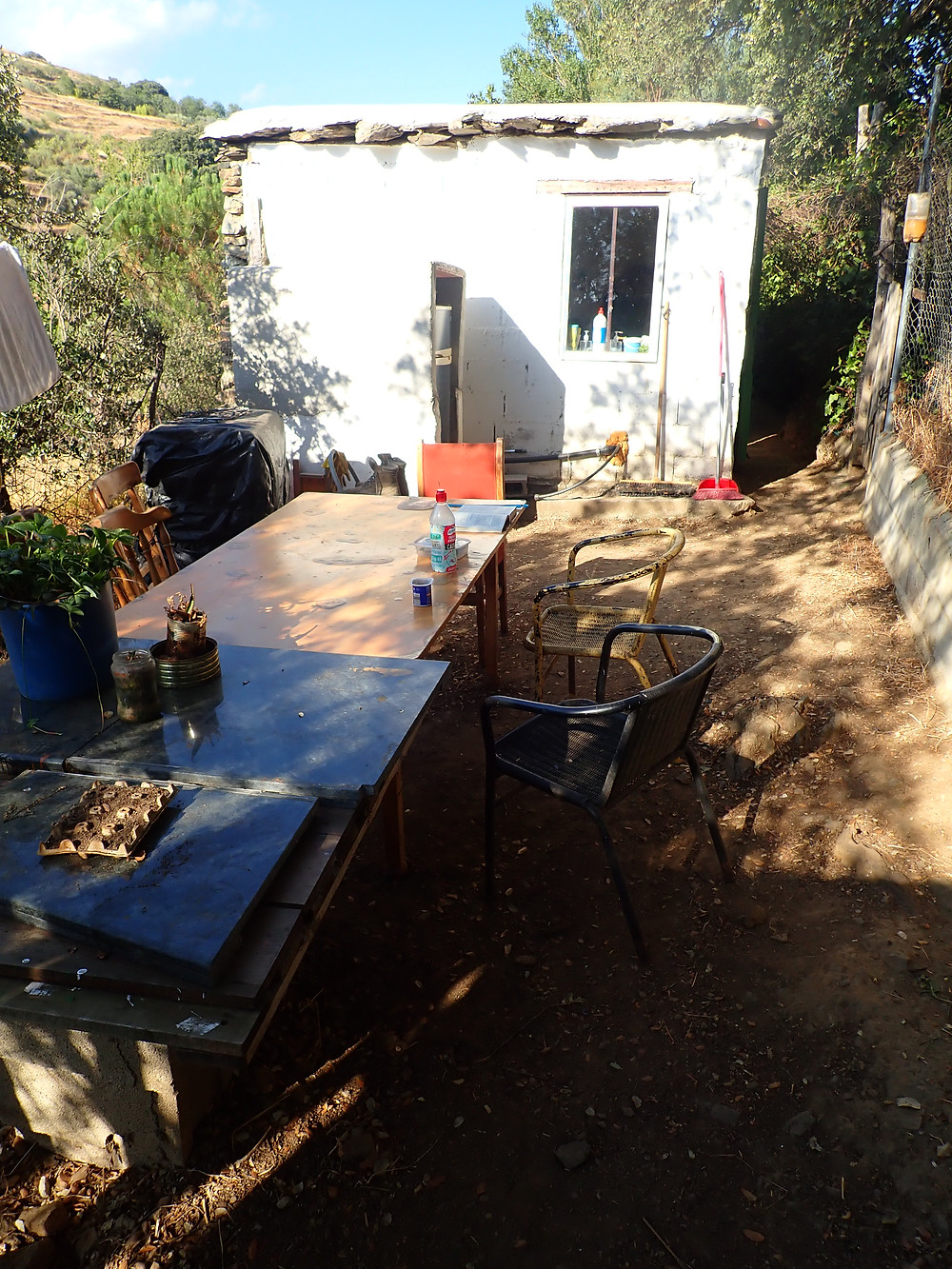 Tables and chairs outside the helpers kitchen, a place to chill and eat
