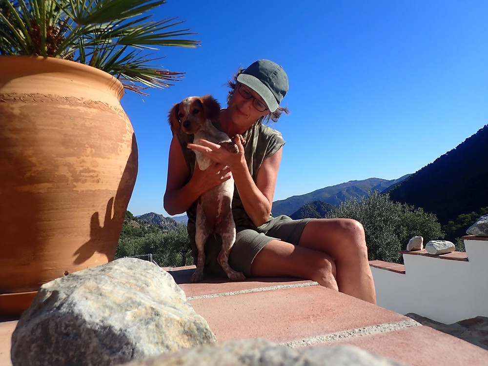 A photo of me and the foster puppy, with mountains in the background