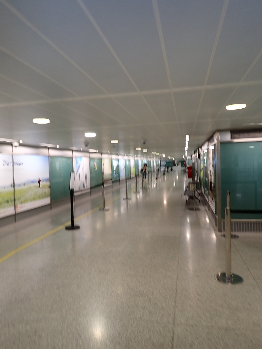 corridor at the airport with hardly anyone in it