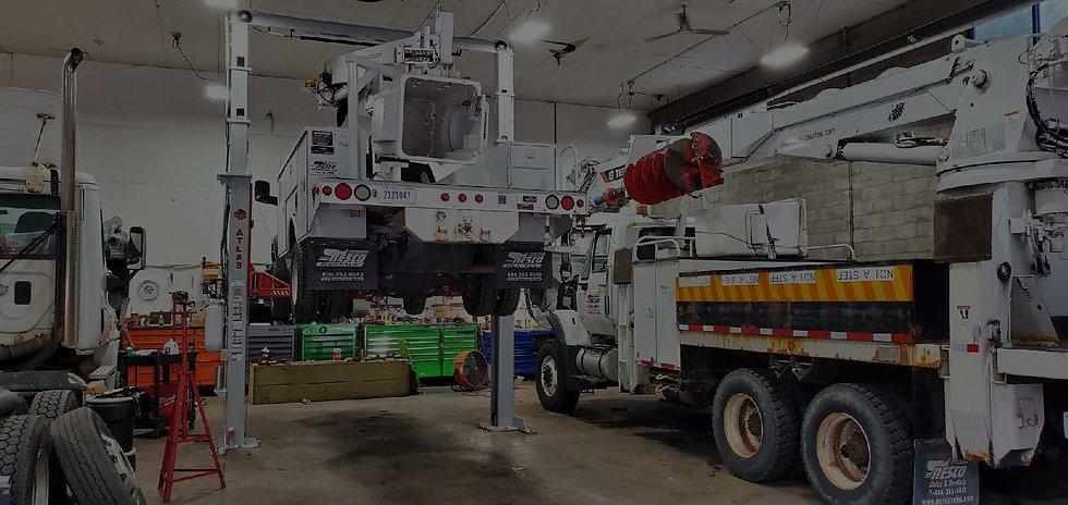 crane-trucks-on-lifts.jpg