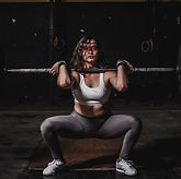 woman-lifting-barbell-1552249_edited.jpg