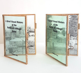 A Brief Visual History of the Battle of Ichhogil Bund - Volume One, 2019 Graphite on mylar in brass frames,11 x 9 cm.   On September 6, 1965, a brief yet significant battle was fought in the outskirts of Lahore at the banks of Ichhogil canal. This canal runs parallel to the border between Pakistan and India and is an extension of the famous Lahore canal. There are varying accounts of what unfolded and how deep the opposing forces transgressed. However, the fact remains that blood was shed and lives were lost in an attempt to redefine the boundaries of two nations. These two books act as war diaries boiling down the events of the day in the form of collapsed bridges and bombed homes. Stripped of heroic narrative and lengthy battle descriptions, the images tell their own story of gain and loss.