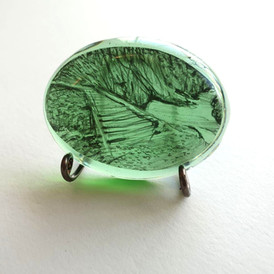 Graphite on mylar, cast in resin, 4cm x 3 cm.