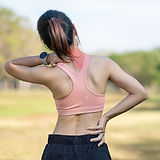 bigstock-Young-Fitness-Woman-Holding-He-