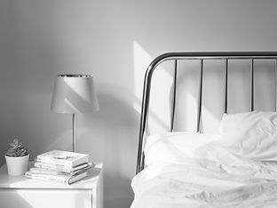 table lamp on white wooden nightstand be