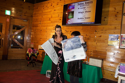 Zatanna, magicians Perth, illusionist and mentalist. Magic show in Japan with a newspaper. Best magic in Perth.