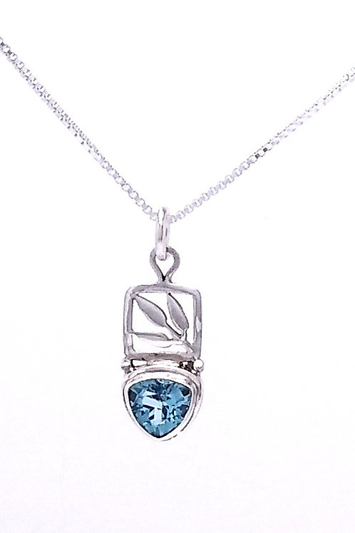 Sterling Silver Pendant With Blue Topaz And Leaf Detail