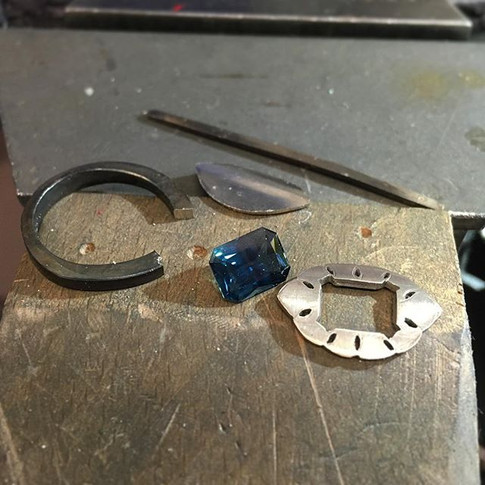 Step 3- the top plate is cut out, the wire is ready to be made into claws, and the band has started to be formed.jpg