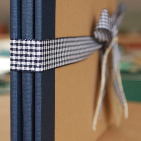 Navy and kraft photographic album