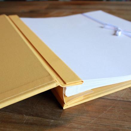 Yellow book cloth scrapbook album