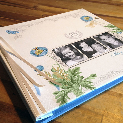 Custom canvas cover scrapbook anniversary photo album. Vintage floral cover in cream and blues with collage of photo frames