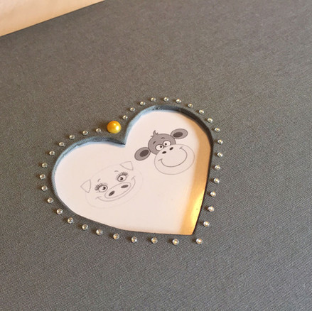 """Grey """"Marry Me"""" album with heart cut out"""