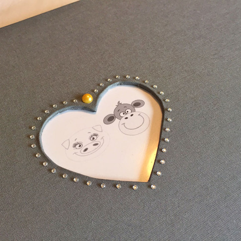 "Grey ""Marry Me"" album with heart cut out"