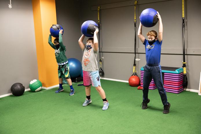 Kids Throwing Medicine Balls