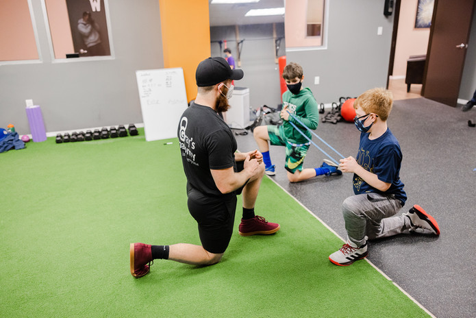 Zack Assisting Youth Athletes During Training