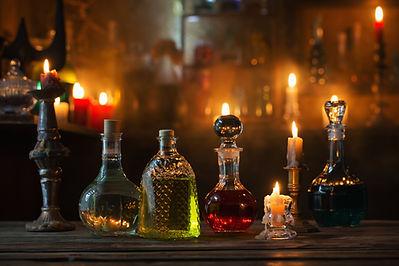 magic potions in bottles on wooden backg
