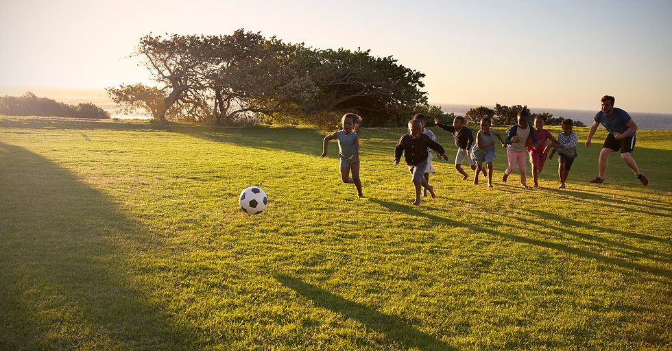 teacher-and-elementary-school-kids-play-
