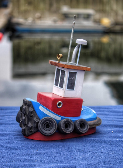 Red white and blue tugboat