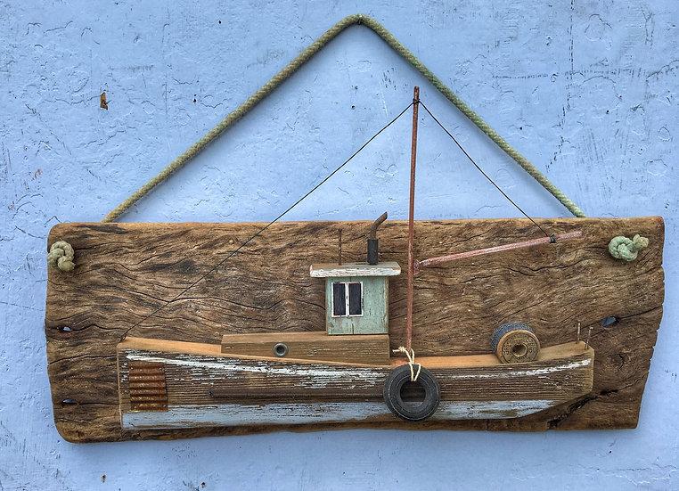 Vintage gillnetter on driftwood background