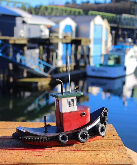 medium red tugboat side view