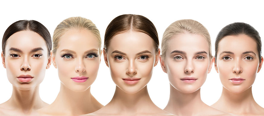 Different skin tones women faces with he