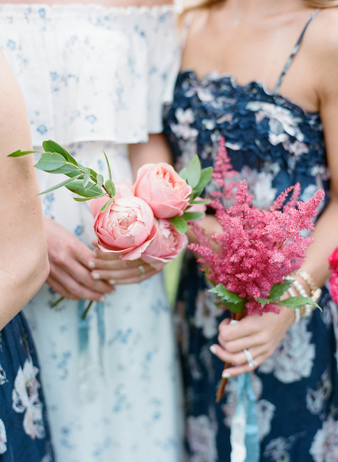 Two Bridesmaids holding Single Element Bouquets of Pink Roses and Pink Astilbe
