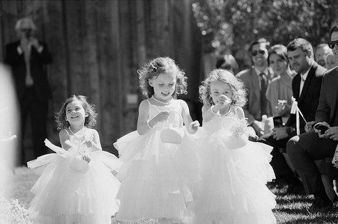 Flower Girls Smiling and Running Down the Aisle