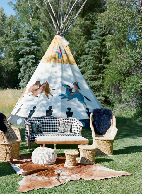 Buffalo Check Couch with Straw Chairs and Teepee