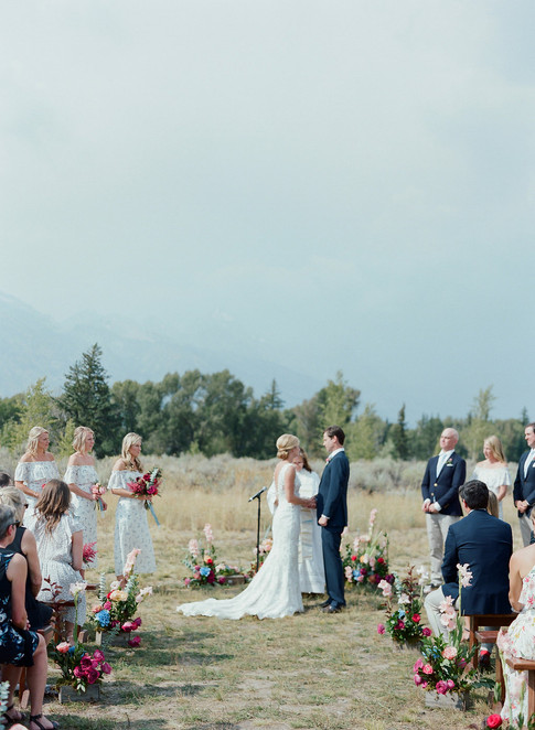 Bride and Groom Facing each other During Wedding Ceremony in a field