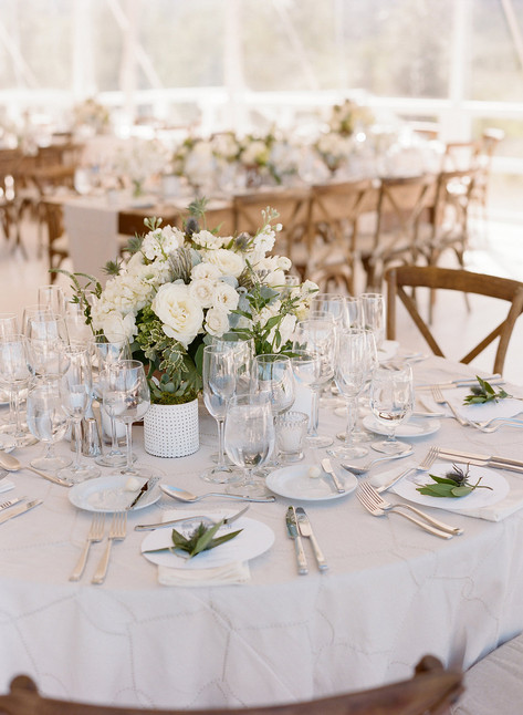 Round Table with Light Grey Patterned Linen, Whtie and Green Flowers and Glassware